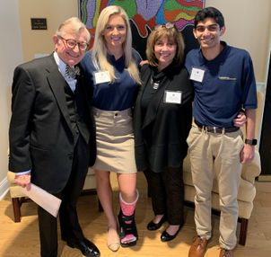 President Gordon Gee and Dr. Carolyn Atkins congratulate 2018 WVU Foundation Scholars, Ashley Eby and Shamil Patel,