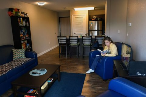 University Park living room with student