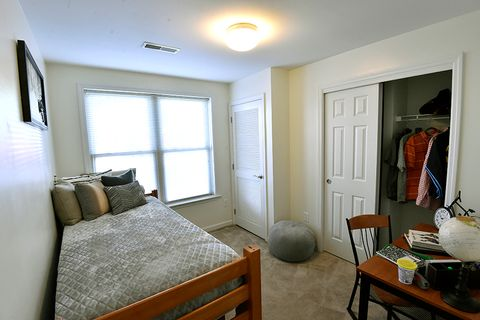 room with bed, closet and desk