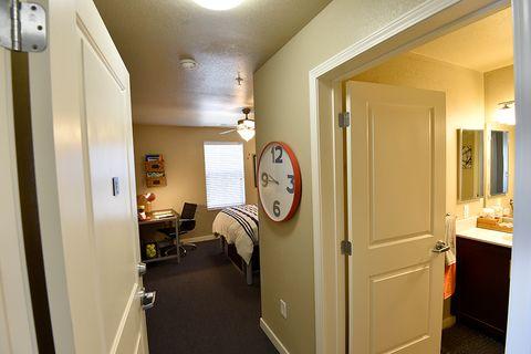 hallway with large clock