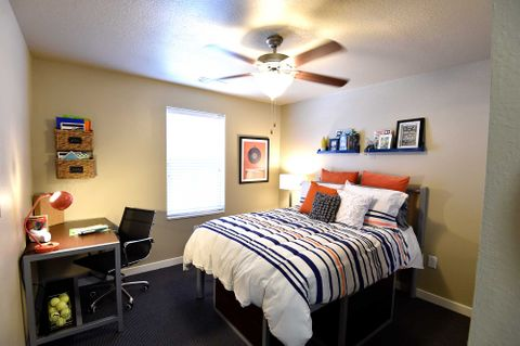 room with a bed and ceiling fan