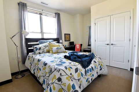 furnished bedroom with floral bed spread