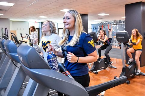 students working out on treadmills
