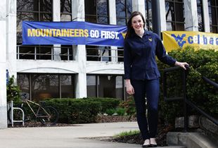 Chelsea Arvin standing in front of the Mountainlair.