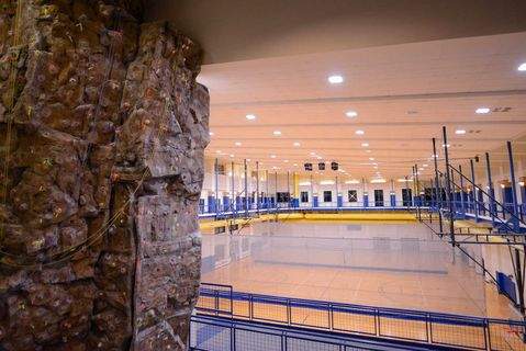 view of the climbing wall and running track