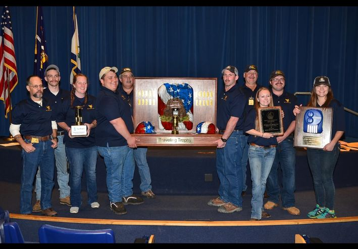 A picture of the Gold mine rescue team with trophies.