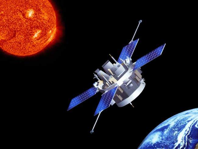 A space craft approaches a planet in outer space.