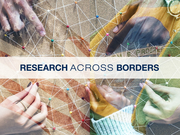 Hands shown on a flag with the text research across borders.