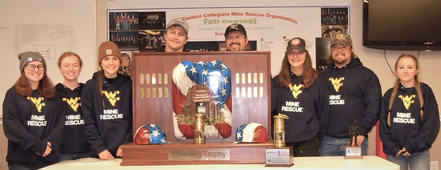 A photo of the mine rescue team with trophy.