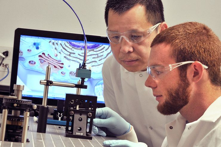 Scott Cushing performs research with his professor, Dr. Nick Wu.