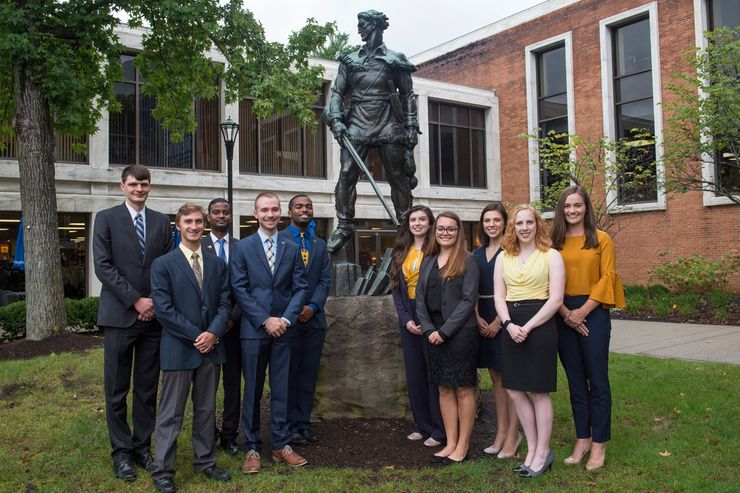 All of the students competing for the titles of Mr. and Ms. Mountaineer posing in front of the Mountaineer statue.