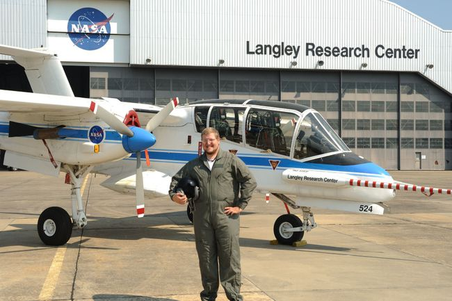 Matt Underwood stands in front of an airplane at Langley Research Center